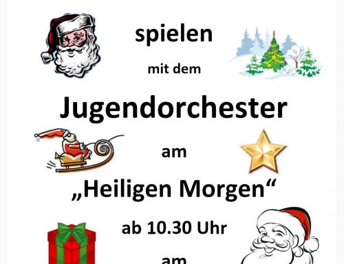 Traditionelles Weihnachtslieder spielen des JO am Heilig Morgen